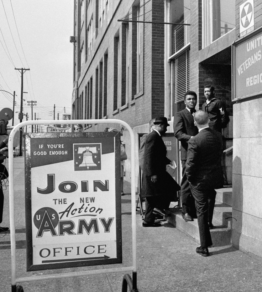 """In this March 17, 1966 file photo, heavyweight boxing champion Muhammad Ali arrives at a Veterans Administration office in Louisville, Ky. to appeal his 1A draft classification. Behind him wearing a hat is his attorney, Edward Jocko of New York. """"I ain't got no quarrel with those Viet Cong,"""" he said, setting off on a path that cost him more than three years of his career and nearly put him in prison. Ali became a symbolic, if unlikely, figure of the anti-war movement, though his mind was always more on resuming his career than furthering the cause."""