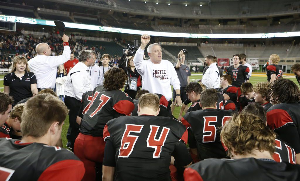 Argyle Eagles head coach Todd Rodgers gather the team for a prayer after the game during the second half of a 4A High School State Semifinals football game between Argyle Eagles Vs Abilene Wylie Bulldogs on Friday, December 11, 2015, in Waco, Texas. DRC Jose Yau