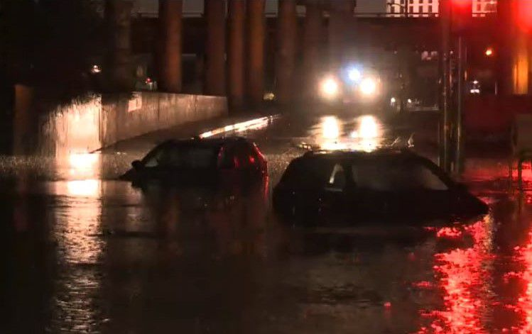 Two cars were swamped by high waters during overnight storms last month on Victory Avenue at the northwest corner of downtown Dallas.