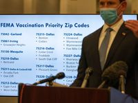 A monitor displays vaccination priority zip codes for COVID-19 as Dallas County Judge Clay Jenkins conducts a press conference about the COVID-19 vaccine operations with FEMA, on Tuesday, Feb. 23, 2021 at Fair Park in Dallas.