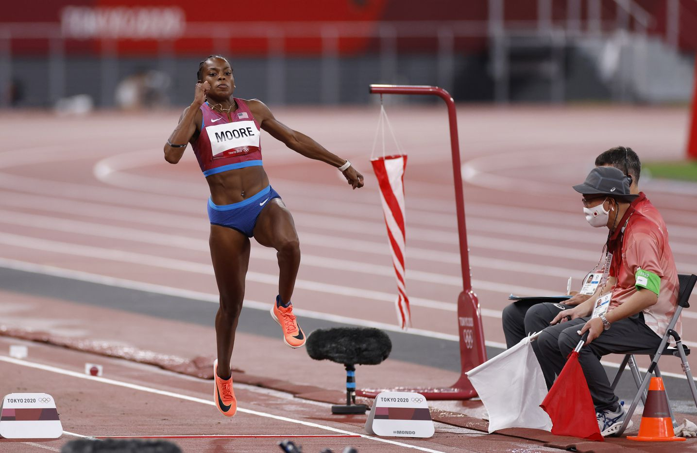 USA's Jasmine Moore competes in the women's triple jump qualification round during the postponed 2020 Tokyo Olympics at Olympic Stadium, on Friday, July 30, 2021, in Tokyo, Japan. Moore did not advance to the next round. (Vernon Bryant/The Dallas Morning News)