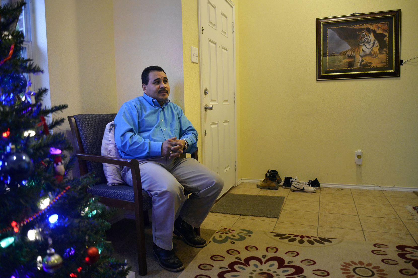 Adan Barahona sits while talking about his daughter in his home on Sunday, December 20, 2015 in Dallas. Barahona is waiting for his daughter Giselle Barahona, 21, who will be a CAM refugee from Honduras.
