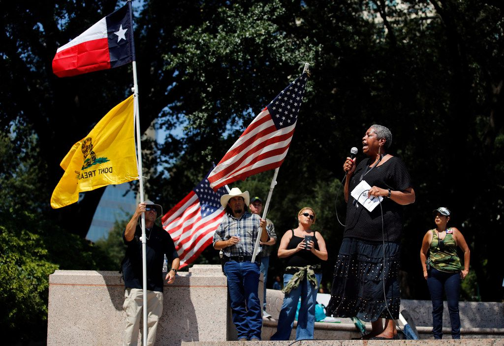 Former Dallas City Councilwoman Sandra Crenshaw speaks at This Is Texas Freedom Force protest Saturday over removal of the Robert E. Lee statue from Lee Park in Dallas. The statue was removed from Lee Park on Thursday.