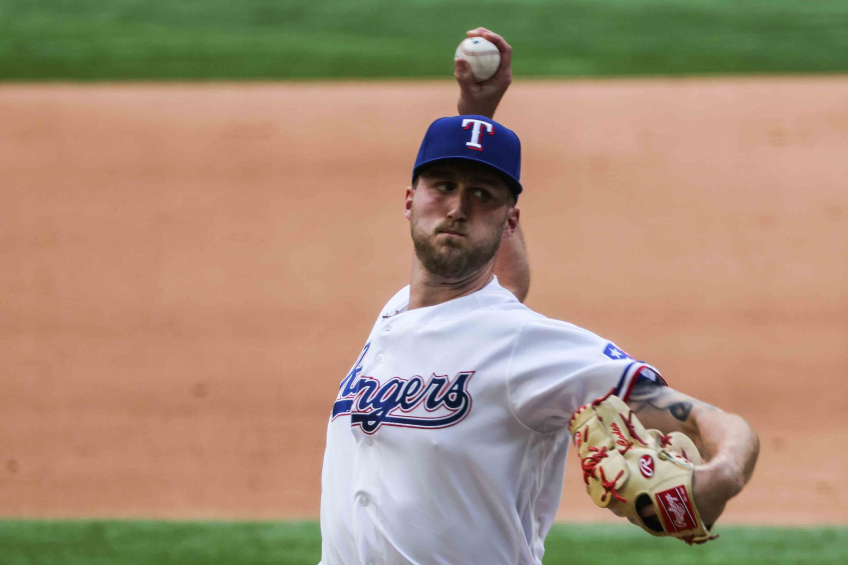 Texas Rangers' Kyle Cody No. 54 pitches against Toronto Blue Jays at the Globe Life Field during opening day in Arlington, Texas on Monday, April 5, 2021. (Lola Gomez/The Dallas Morning News)