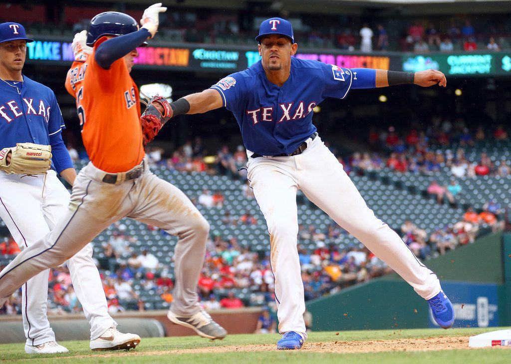 Ronald Guzman (11) of the Texas Rangers tags out Myles Straw (26) of the Houston Astros in the eighth inning on Sunday, July 14, 2019 at Globe Life Park in Arlington in Arlington, Texas. (Rick Yeatts/Getty Images/TNS)