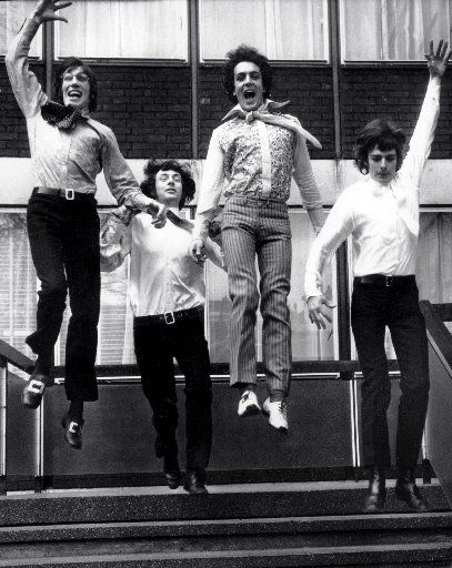 In this file photo dated March 3, 1967, members of the rock band Pink Floyd, Roger Waters, left, Nick Mason, second from left, Syd Barrett, second from right, and Richard Wright, right, leap from the steps of EMI House in London.