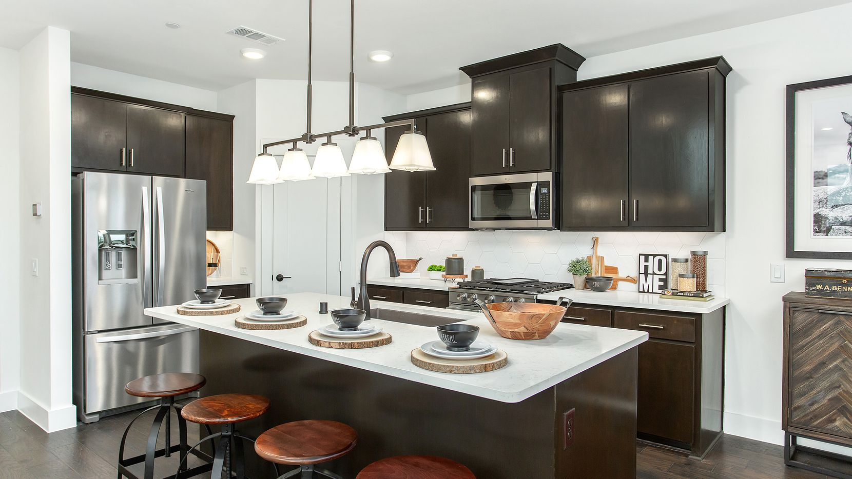 Two- and three-bedroom luxury townhomes will be ready for move-in soon at Woodbridge Townhomes, a new Wylie community by Grenadier Homes.