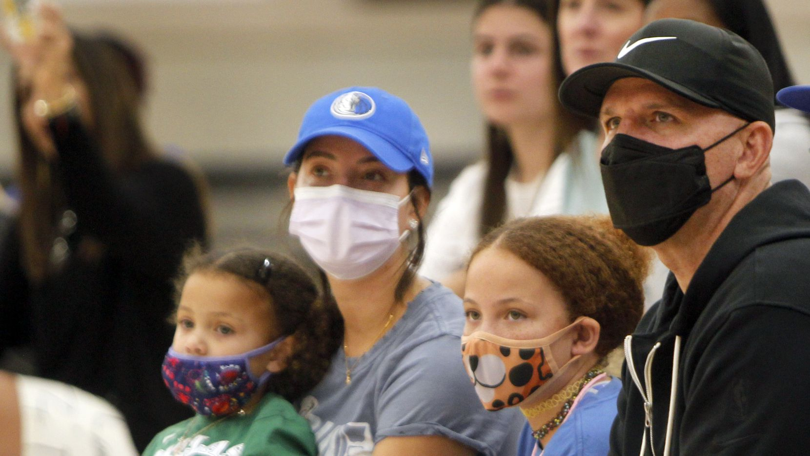 Dallas Mavericks head coach Jason Kidd, right, watches alongside his family in attendance for a girls basketball game featuring Kidd Select, a team the family sponsors. Pictured to Kidd's right are daughter Noah, 9; wife Porschla and daughter Cooper, 3. The basketball tournament was held at Fieldhouse USA in Mansfield on August 21, 2021.