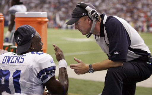 FILE - Sept. 9, 2007: Cowboys wide receiver Terrell Owens talks with assistant coach Jason Garrett on the sideline during the first quarter of the season opener at Texas Stadium in Irving.