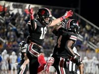 Lovejoy's Parker Livingstone (18) celebrates with Kyle Parker (4) after Parker's touchdown reception in the first half of a high school football game between Frisco and Lovejoy, Friday, Oct. 22, 2021, in Lucas, Texas.