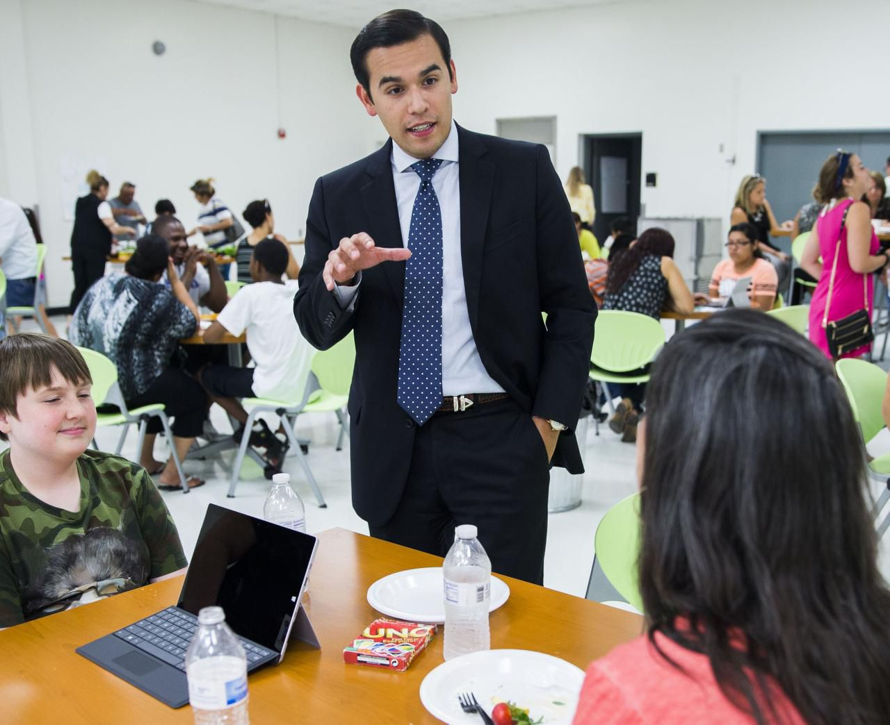 DISD School Board President Miguel Solis chats with James (left) and Karen Slate.