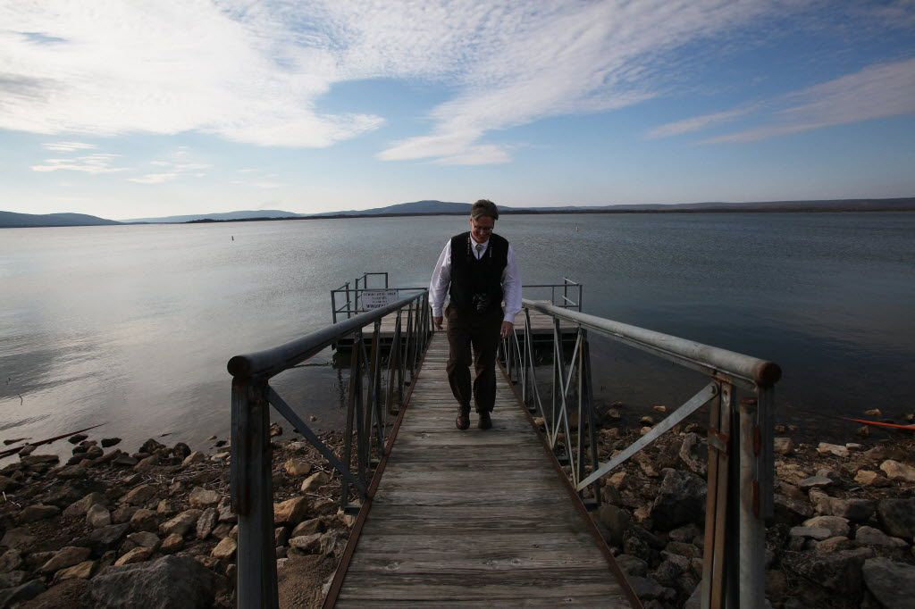 Stephen Greetham, the lawyer for the Chickasaw nation, walks up a pier on Sardis Lake, near Tuskahoma, Okla. The state and the Chickasaw and Choctaw nations have agreed to a settlement that does not give the tribes the authority to sell water to North Texas water districts.