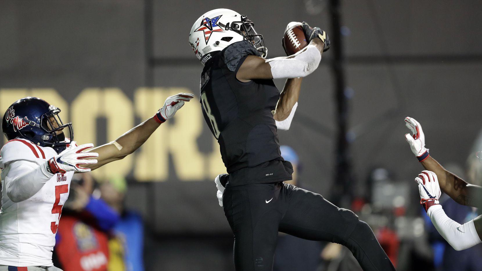 FILE - Vanderbilt cornerback Joejuan Williams (8) intercepts a pass intended for Ole Miss wide receiver DaMarkus Lodge (5) during the second half of a game on Saturday, Nov. 17, 2018, in Nashville, Tenn. (AP Photo/Mark Humphrey)