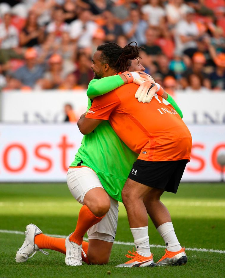 "Dirk Nowitzki and Patrick Owomoyela (R) of Nowitzki All Stars hug during the ""Champions for Charity"" friendly football match at Bay Arena on July 21, 2019 in Leverkusen, western Germany. (Photo by INA FASSBENDER / AFP)INA FASSBENDER/AFP/Getty Images"