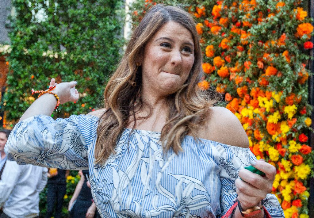 Lucinda Beaumont drinks her shot at the Eye Ball Party celebrating the Dallas Art Fair in Dallas. (Ron Heflin/Special Contributor)