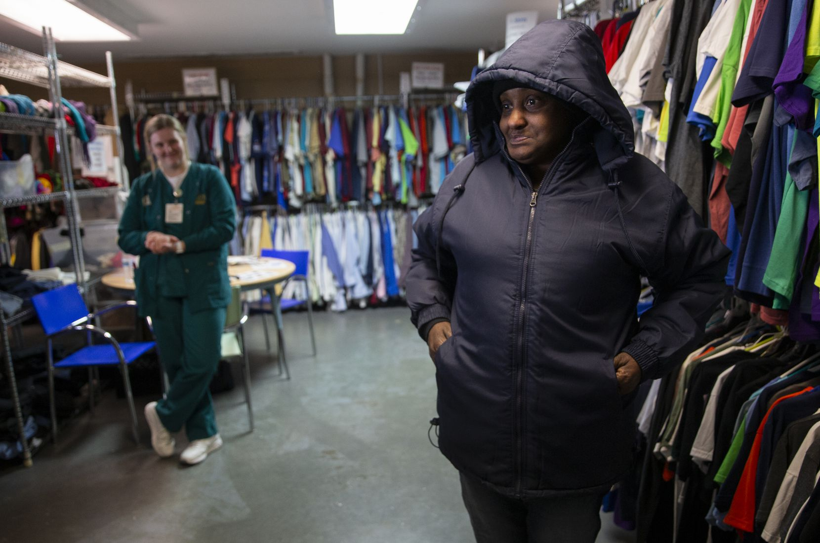 Cecelia Nash (right) tried on a new jacket at the Cornerstone Baptist Church's Clothes Closet on Dec. 5, 2019 in Dallas. Cornerstone Community Development Corp. was one of 23 nonprofits that received funds from The Dallas Morning News Charities campaign.