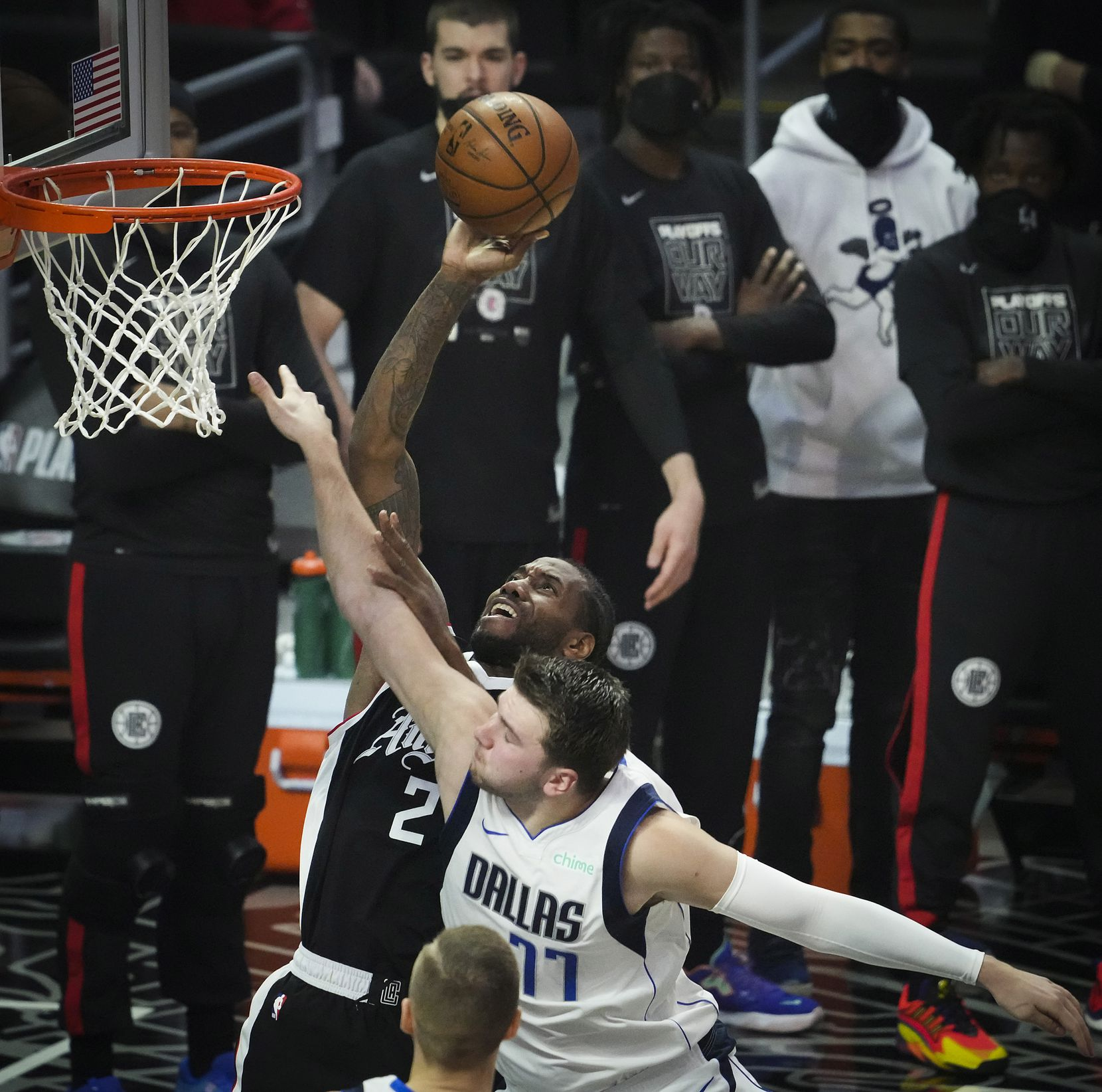 LA Clippers forward Kawhi Leonard (2) scores past Dallas Mavericks guard Luka Doncic (77) during the first quarter of Game 7 of an NBA playoff series at the Staples Center on Sunday, June 6, 2021, in Los Angeles.