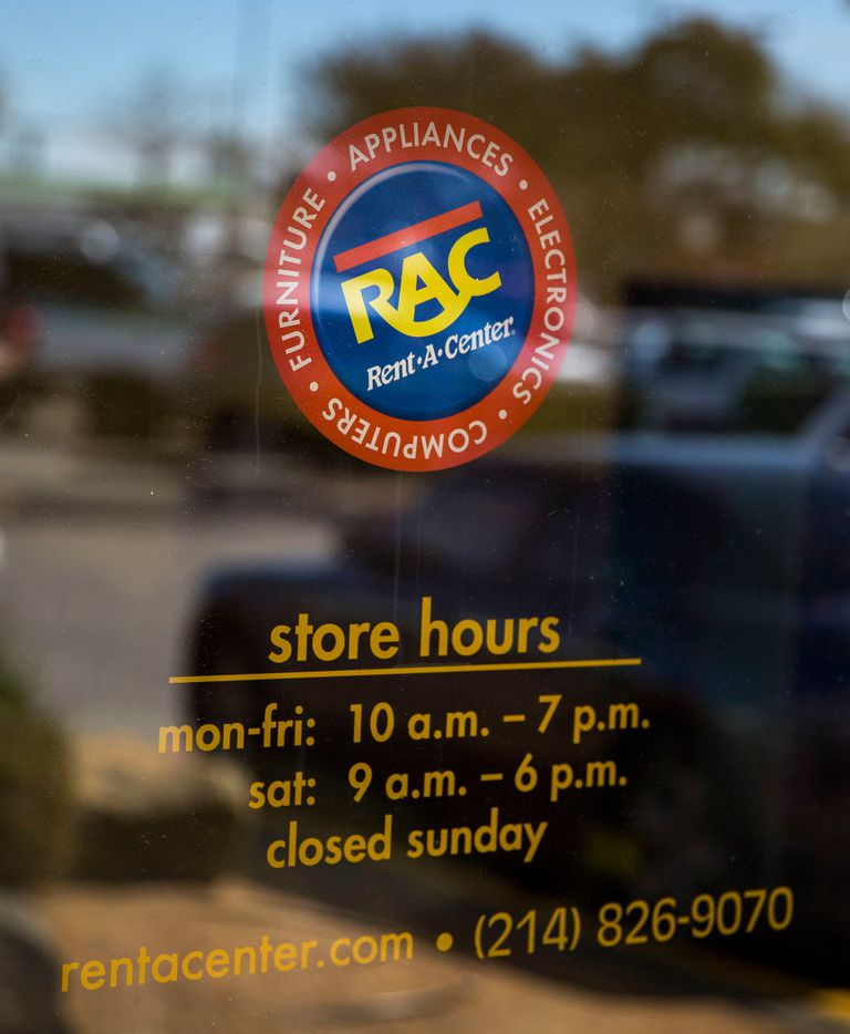 A sign on the front doorof a Rent-A-Center on the 5300 block of Ross Avenue in Dallas.