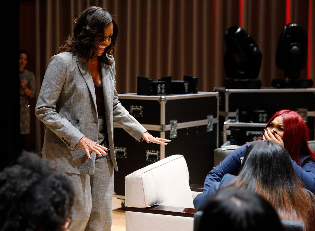 Ashawnti Black (right), 18 of Irma Rangel Young Women's Leadership School covers her mouth in shock as former first lady Michelle Obama surprises high school students from the Dallas area during the first annual Young Women's Leadership Conference at Winspear Opera House.