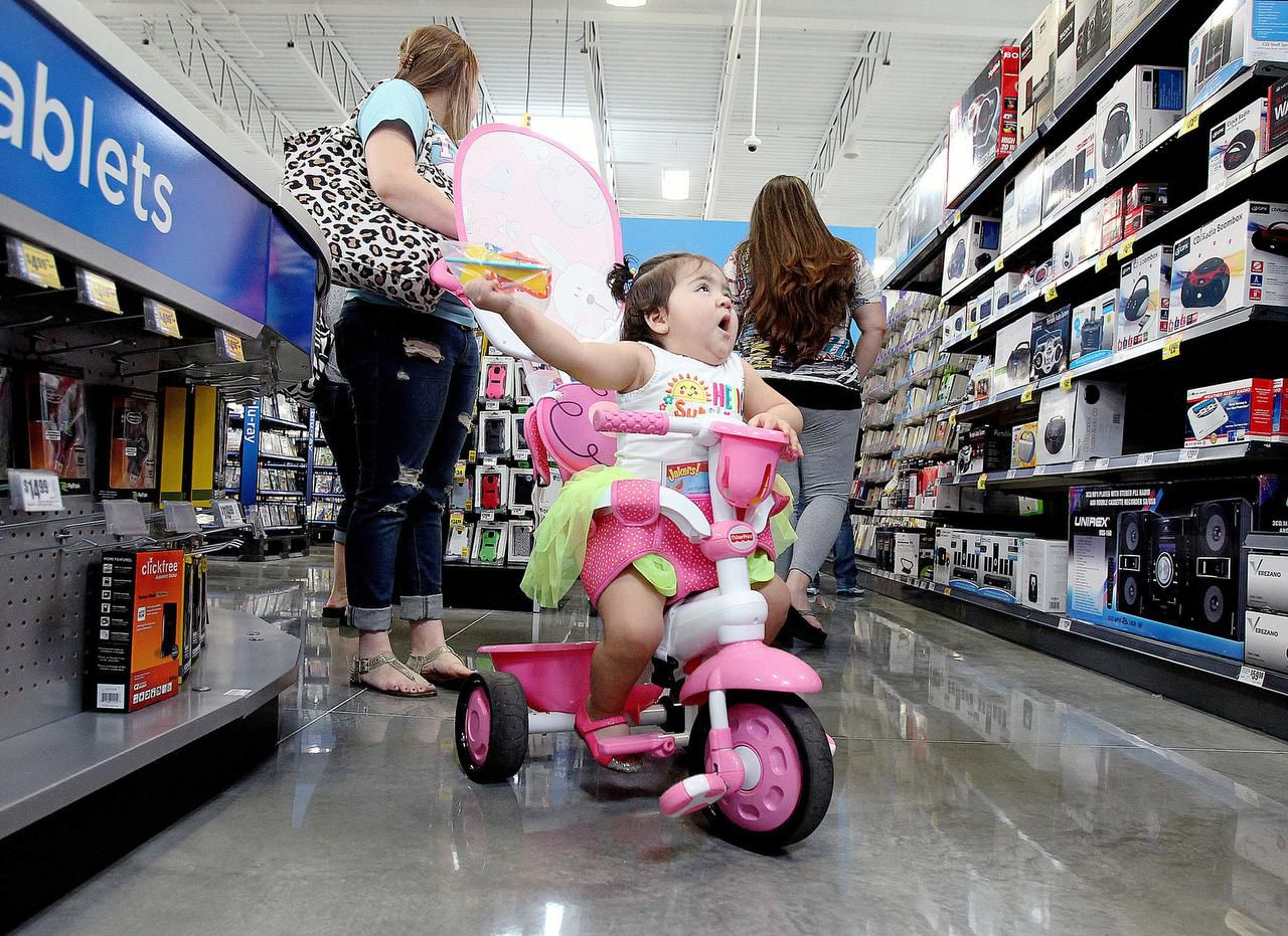 As her mother shops, Kamila Coronado, 1, is dazzled by the electronics on the shelves of an H-E-B Plus store in Waco.