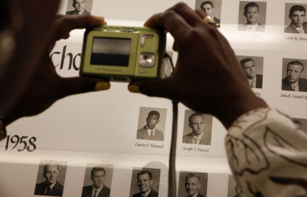 Nedra Grisby photographs a picture of Charles Edmond, the first black student to graduate from Jesuit in Dallas.