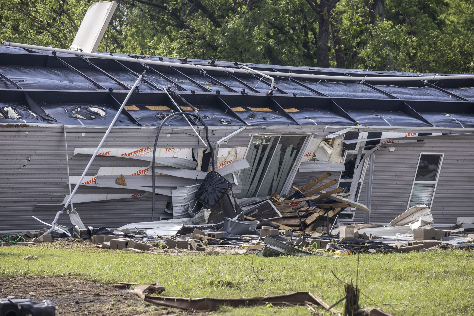 A mobile home was turned upside down in the aftermath of a Monday night tornado that touched down just south of Waxahachie, Texas, on Tuesday, May 4, 2021. (Lynda M. González/The Dallas Morning News)
