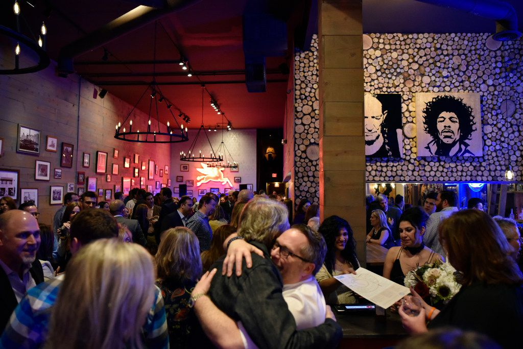 Chef Dean Fearing, left, hugs Jeffrey Kollinger, owner of Tillman's Roadhouse restaurant, as they see each other during a relaunch party for the restaurant in Bishop Arts, on Tuesday, Jan. 10, 2017 in Dallas. Ben Torres/Special Contributor
