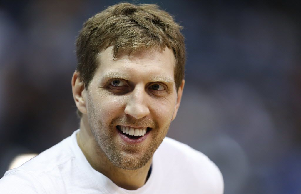 FILE - In this April 8, 2016, file photo, Dallas Mavericks' Dirk Nowitzki smiles during team warm-ups before an NBA basketball game against the Memphis Grizzlies in Dallas. A person with knowledge of the deal says the Mavericks and Nowitzki have reached agreement on a two-year contract that could get the star forward to 20 seasons in Dallas. The agreement would be worth roughly $20 million per season with a player option in the second year, the person told The Associated Press on Tuesday, July 5, 2016, on condition of anonymity because contracts can't be signed until late Wednesday night Central time. (AP Photo/Jim Cowsert, File)