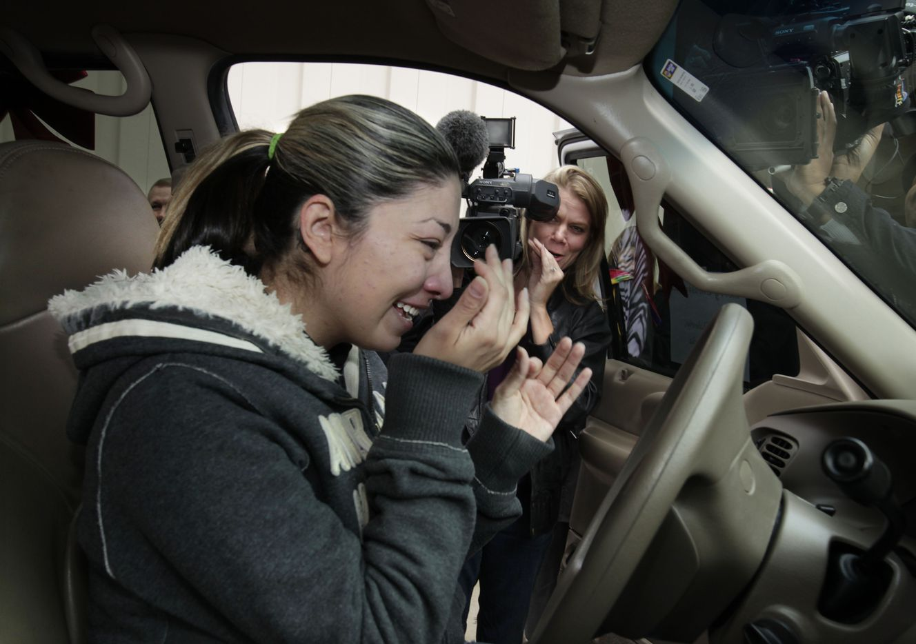 Rose Mares was overcome with emotion as she sat in the driver's seat of her Christmas gift for the first time at Frisco Family Services on Dec. 23, 2010. Mares and her two daughters had no transportation for some time after her old car, nicknamed Halie, was wrecked and would no longer run. Mares and her 7-year-old daughter Victoria Partain and 5-year-old daughter Valerie Partain turned to Frisco Family Services for food after a temporary layoff. Frisco Automotive & Transmission owner Charles Haley learned of the family's hardship and donated a used Ford Expedition with a new engine and free oil changes for a year.