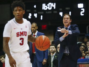 Southern Methodist Mustangs head coach Tim Jankovich calls out a play as Southern Methodist Mustangs guard Kendric Davis (3) waits for the offense to set during the first half of am NCAA men's basketball matchup between SMU and Wichita State on Sunday, March 1, 2020 at Moody Coliseum in University Park, Texas.