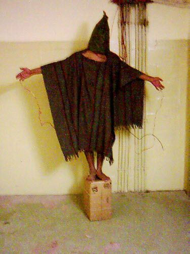This is an image obtained by The Associated Press that shows an unidentified detainee standing on a box with a bag on his head and wires attached to him in late 2003 at the Abu Ghraib prison in Baghdad, Iraq.