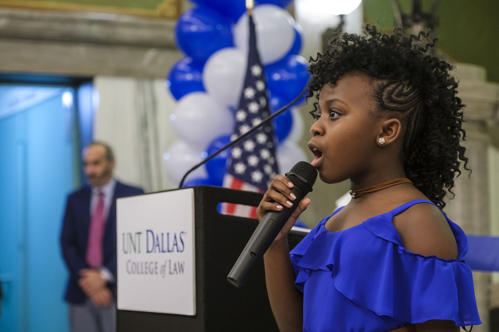 Skye Turner sings the national anthem during a ceremony for the UNT Dallas College of Law in 2019.