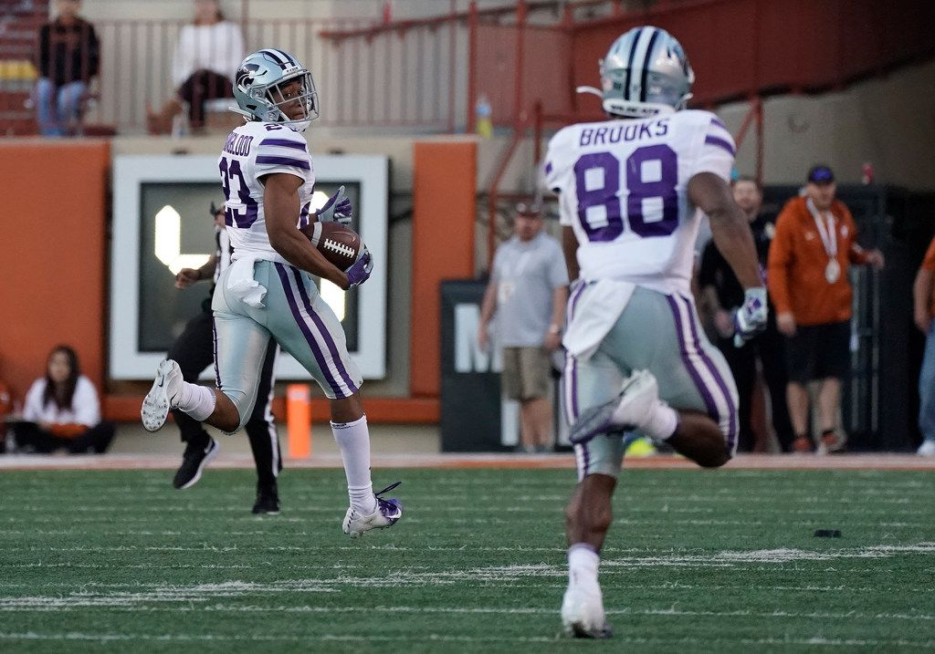 Kansas State's Joshua Youngblood (23) returns a kickoff for a touchdown against Texas during the second half of an NCAA college football game in Austin, Texas, Saturday, Nov. 9, 2019. (AP Photo/Chuck Burton)