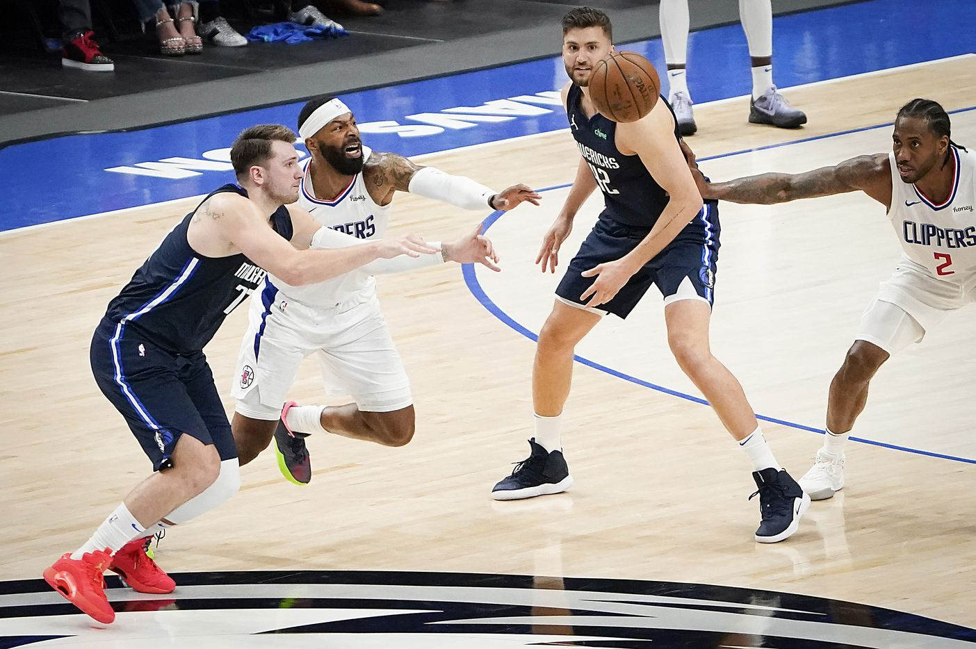 LA Clippers forward Marcus Morris Sr. (8) knocks the ball away from Dallas Mavericks guard Luka Doncic (77) during the fourth quarter of an NBA playoff basketball game at American Airlines Center on Friday, May 28, 2021, in Dallas.