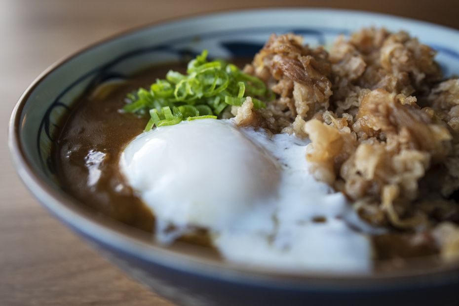 A bowl of curry nikutama is made with seasoned sweet beef, soft egg and curry sauce at Marugame.