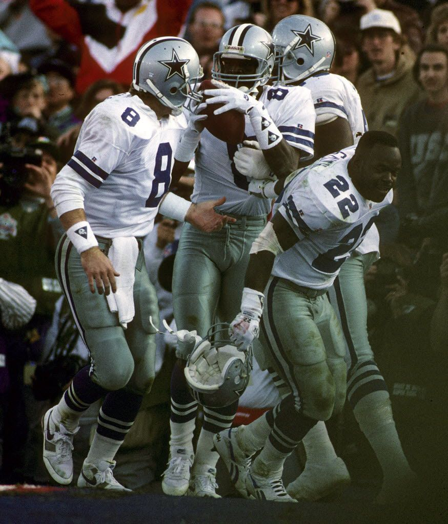 Dallas Cowboys running back Emmitt Smith (22) and Hall of Fame quarterback Troy Aikman (8) help wide receiver Michael Irvin (88) celebrate a touchdown catch during Super Bowl XXVII, a 52-17 victory over the Buffalo Bills on January 31, 1993, at the Rose B  (AP Photo/NFL Photos) ORG XMIT: NFLNY01