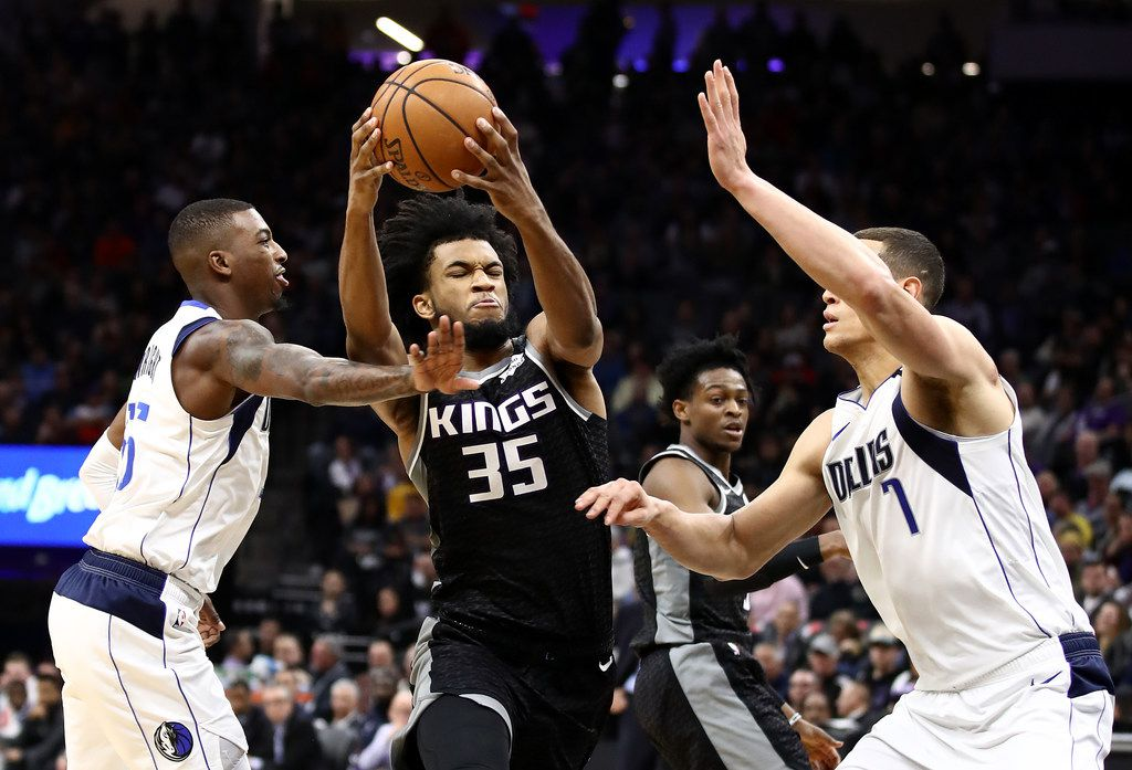 SACRAMENTO, CALIFORNIA - JANUARY 15:  Marvin Bagley III #35 of the Sacramento Kings drives on Dwight Powell #7 and Delon Wright #55 of the Dallas Mavericks at Golden 1 Center on January 15, 2020 in Sacramento, California.  NOTE TO USER: User expressly acknowledges and agrees that, by downloading and or using this photograph, User is consenting to the terms and conditions of the Getty Images License Agreement.  (Photo by Ezra Shaw/Getty Images)