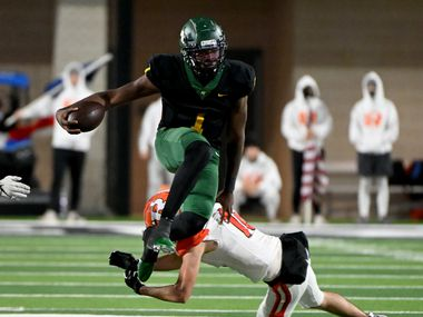 DeSoto's Samari Collier hurdles Rockwall's Garrett Lewis in the second half of a Class 6A Division I area-round playoff game between Rockwall and DeSoto, Friday, Dec. 18, 2020, in Prosper, Texas. (Matt Strasen/Special Contributor)