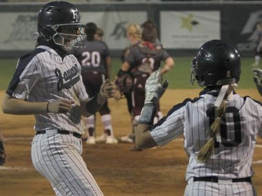 Flower Mound first baseman Jordyn Holland (18), left, was all smiles as she celebrates with teammate Jori Whinery (10) after smashing a three-run home run.