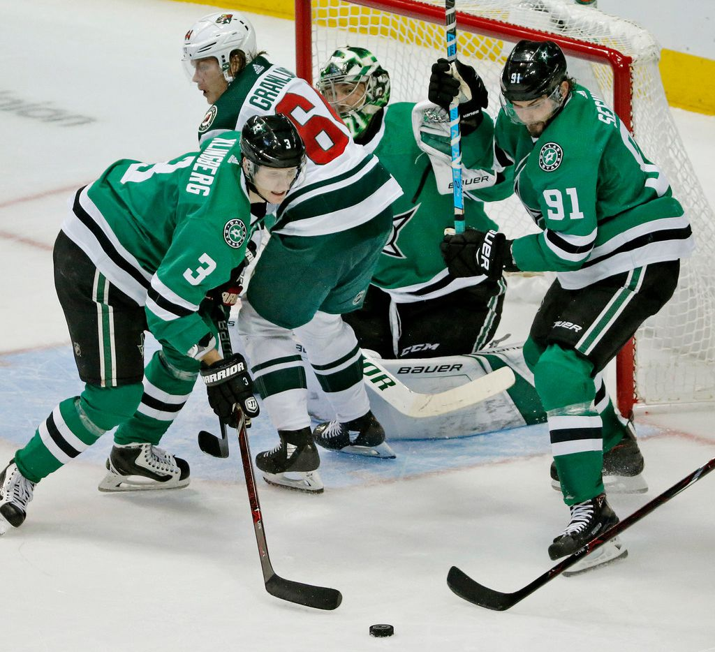 Dallas Stars John Klingberg (3) and Tyler Seguin (91) defend in front of goaltender Ben Bishop (30) during the Minnesota Wild vs. the Dallas Stars NHL hockey game at the American Airlines Center in Dallas on Friday, October 19, 2018. (Louis DeLuca/The Dallas Morning News)