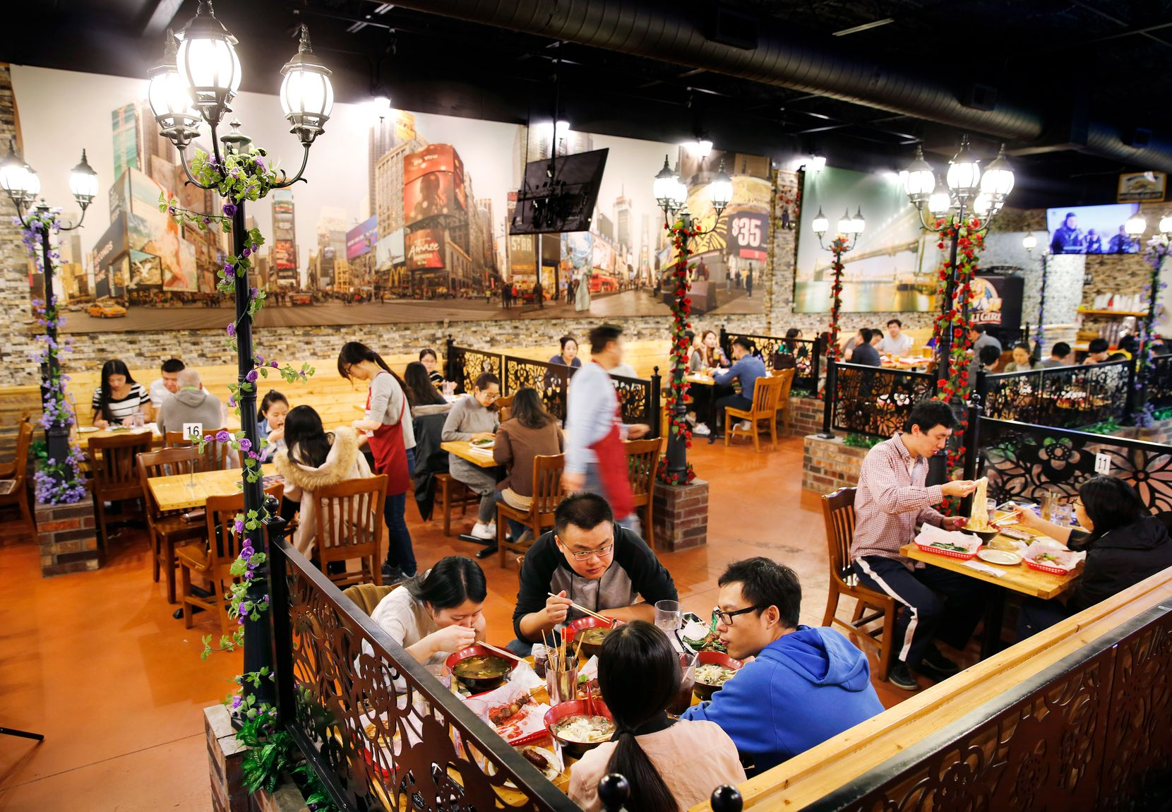 The dining room at FatNi BBQ, which specializes in the kind of Xinjiang-style grilled meat skewers that are hugely popular street-food in Beijing, evokes a street scene.