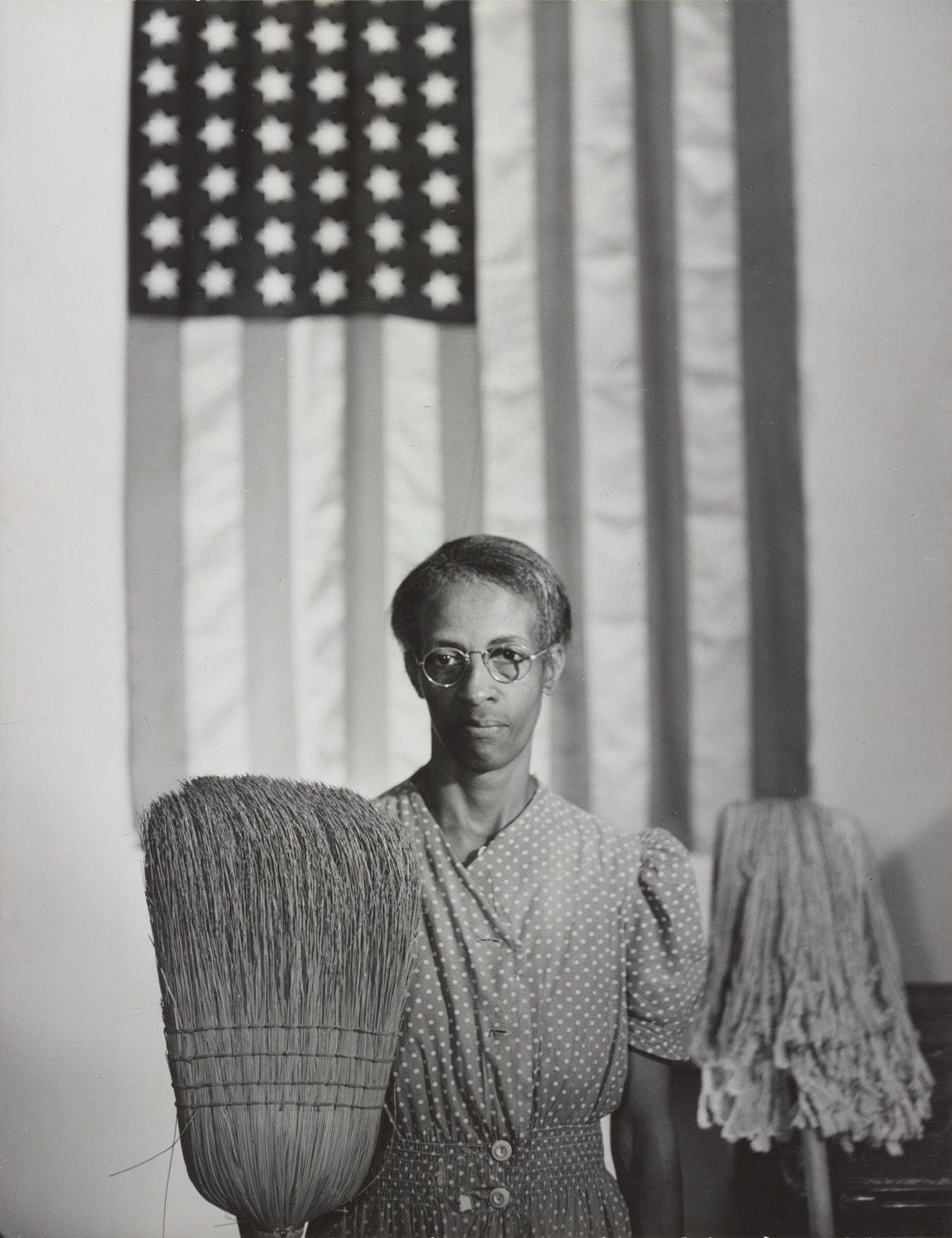 "Highlights of the exhibition include Gordon Parks' 1942 profile of government office cleaner Ella Watson, the subject of Parks' iconic image ""Washington, D.C. Government charwoman,"" which he would later retitle ""American Gothic"" after the Grant Wood painting of the same name."