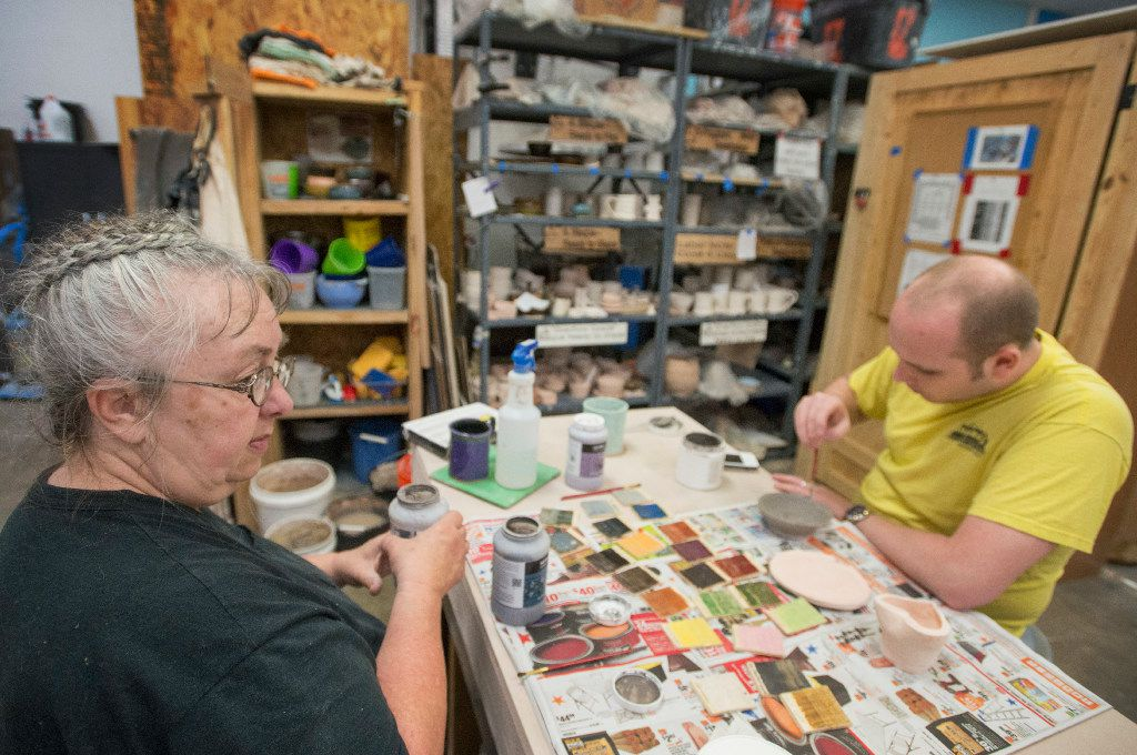 Beth Appleton and Chris Tsongas worked on ceramics projects at the Dallas Makerspace during an open house on June 1 in Carrollton.