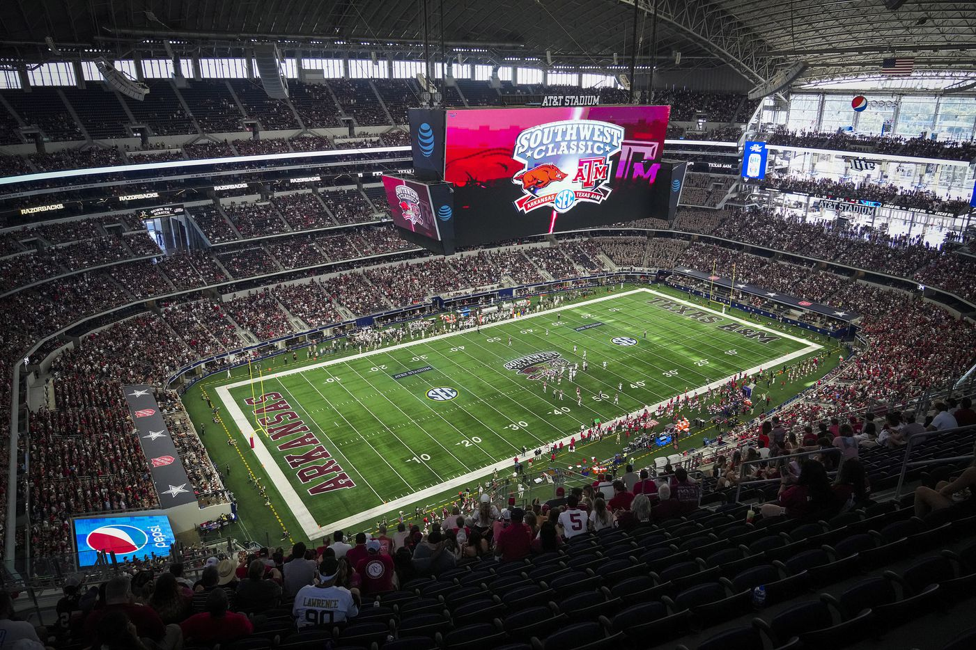 Fans watch Arkansas face Texas A&M during the second half of the Southwest Classic NCAA football game at AT&T Stadium on Saturday, Sept. 25, 2021, in Arlington. Arkansas won the game 20-10.
