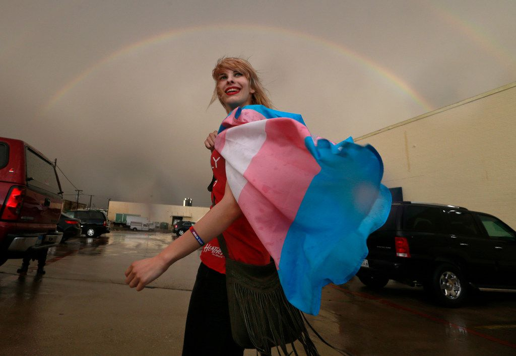 Following a public Fort Worth ISD meeting, at which transgender policies in schools was discussed, Alison Francis of Hurst smiles as a full rainbow appeared over the Fort Worth ISD Board of Education complex in Fort Worth, Tuesday, May 10, 2016.  She said she is part of a transgender couple. Earlier Lt. Gov. Dan Patrick addressed the media on Fort Worth Superintendent Kent Scribner's policy to allow transgender students comfortable access to bathrooms. (Tom Fox/The Dallas Morning News)