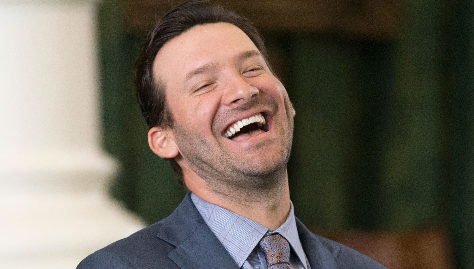 Former Dallas Cowboys quarterback Tony Romo smiles as he is recognized by the Senate at the Texas Capitol in Austin, Wednesday, May 3, 2017.