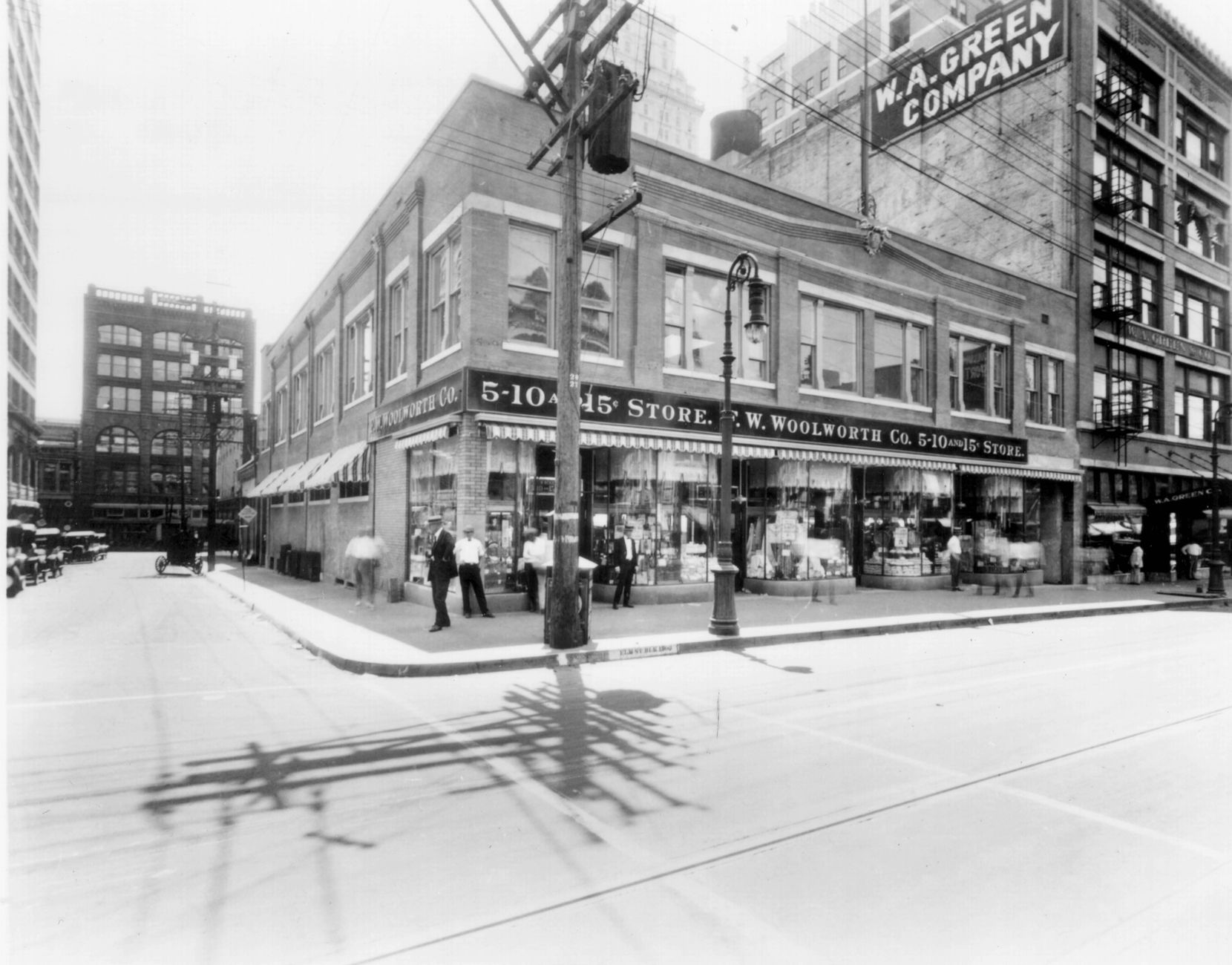 Developers are unveiling plans for retailing on Stone Place, on Main Street in downtown Dallas, and they're looking to the past — such as the way the street appeared in this photo from the 1920s — for their inspiration. [ F.W. Woolworth Co. ]
