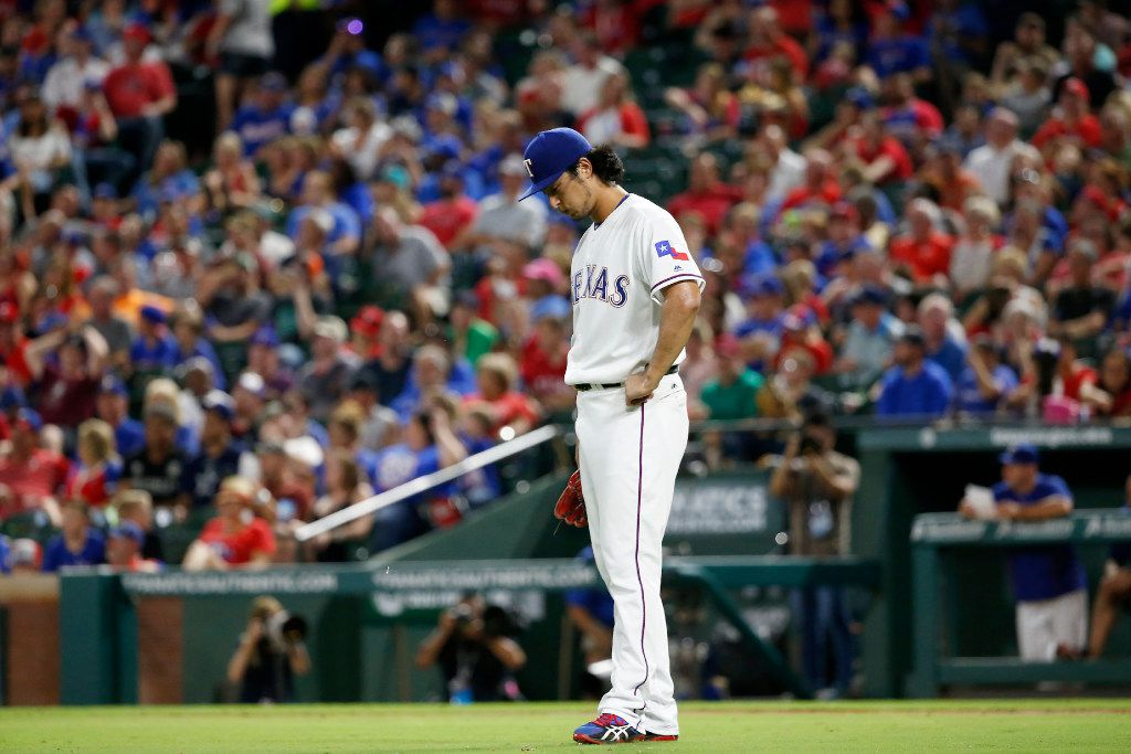 Rangers starting pitcher Yu Darvish hangs his head after giving up a 3-run home run to Athletics shortstop Marcus Semien during the 5th inning at Globe Life Park in Arlington, Texas, Saturday, Sept. 17, 2016. (Jae S. Lee/The Dallas Morning News)