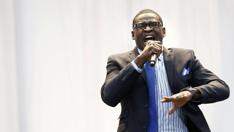 FILE - Cowboys great Michael Irvin speaks before presenting fellow teammate Emmitt Smith with the Tom Landry Legends Award at the 2015 Cowboys kickoff luncheon on Wednesday, Sept. 2, 2015, at AT&T Stadium in Arlington.