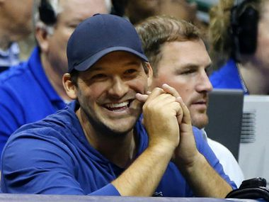 Tony Romo (left) and Dallas Cowboys tight end Jason Witten watch the Dallas Mavericks-Houston Rockets game at the American Airlines Center in Dallas, Wednesday, April 6, 2016.